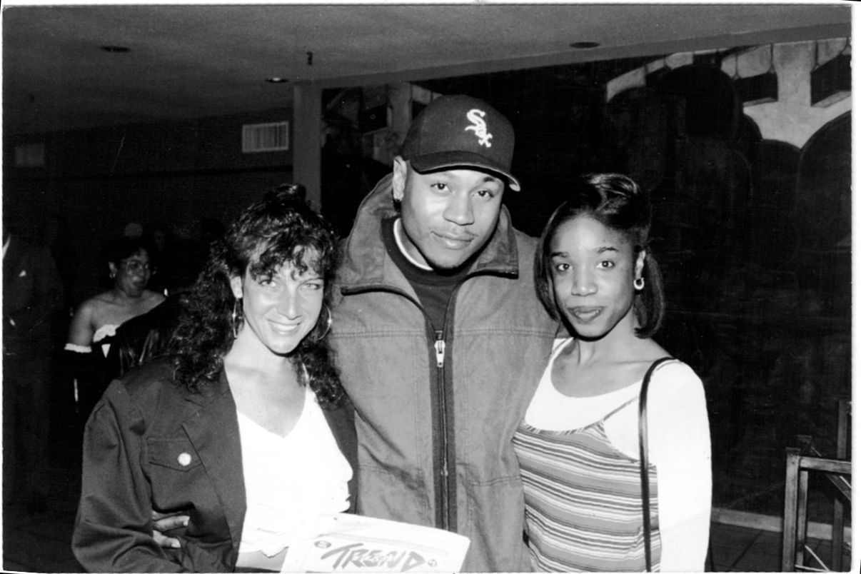 Former New York Trend photographer Carol Marino and former Editor, LaShawn Francis are pictured giving LL Cool J the latest issue of New York Trend.
