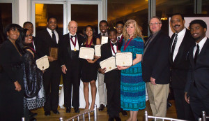 Claes Noble of Nobel Prize family and founder of National Society of High School Scholars (center) is surrounded by student winners at SCIP gala