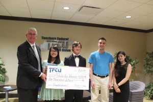 Pictured receiving their $1,000 Scholarship from Thomas A. Fallon, TFCU's Executive Vice President and Chief Operating Officer, are (l to r) Grace Zhang, Kyle Bentley, Andre Fischer and Courtney Chichester. Unavailable for the photo were scholarship winners James Collins and Joseph Darcy.