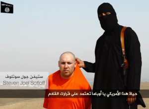 Masked jihadist with the late Steven Sotloff. Courtesy of the Daily News.