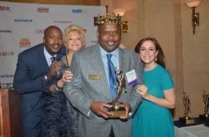 Picture Left to Right: Fox 5 News Anchor Antwan Lewis, Courier Publisher and CEO Victoria Schneps, Phil Andrews, President, LIAACC, and reporter Teresa Priolo (Photo Credit: Queens Courier)