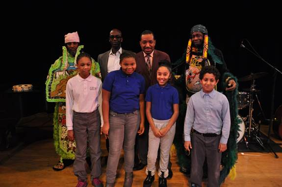International jazz artist and founder of Nouveau Swing Donald Harrison (back row, third from left) recently performed for more the 4,000 NYC school children at the Con Edison-The Town Hall  Black History Month Festival. Con Edison Strategic Partnerships manager Alton Murray (back row, second from left) welcomed everyone. After the show, students from P.S. 284 – The Lew Wallace School in Brooklyn (front row) joined Harrison and ensemble members (below wearing traditional Madri Gras costumes). The dazzling show was filled with blends of jazz, modern R&B, second-line, hip-hop, Mardi Gras Indian tradition and reggae rhythms. The show represents the 19th consecutive Town Hall-Con Edison partnership celebrating Black History Month with free performances for schoolchildren.