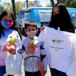 Gloria Angel (far right) with her children proudly showed off the Tee Shirt they were given at the Wyandanch Public Library Mother's Day Extravaganza. Children: (L) Alexia Calderon and © Adrian Calderon. Photo by Gerald Peart.